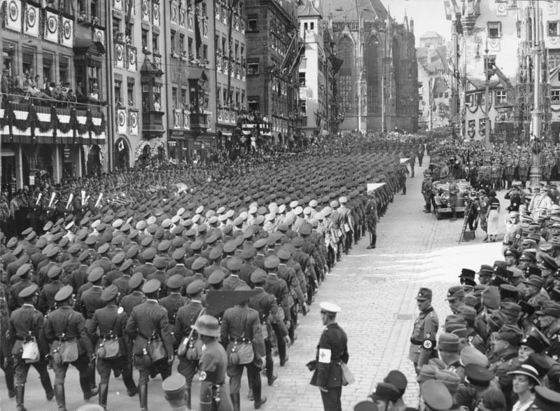 Nazi soldiers march past Hitler in the 1934 propoganda film, Triumph of the Will. [Courtesy Wikimedia Commons.]