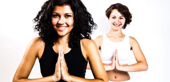 RelaxingMusic-yoga-zen-meditation-girls-women-practicing-smiling-group-exercise-white-background_edited