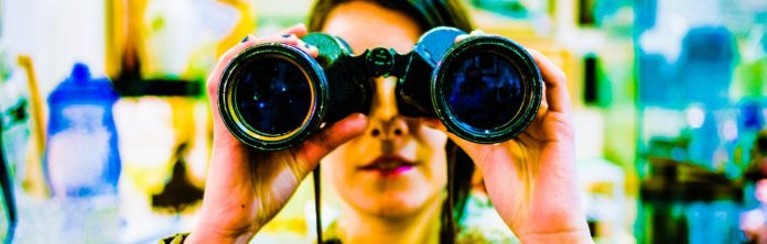 chase_elliott-binoculars-stock-woman-reflection-man-camera-espionage-spying-old-device-apperatus_crop