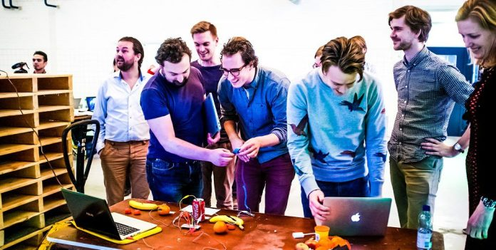 Design-Thinking-Group-Ideation-Workshop-Brainstorming-Working-Hackathon