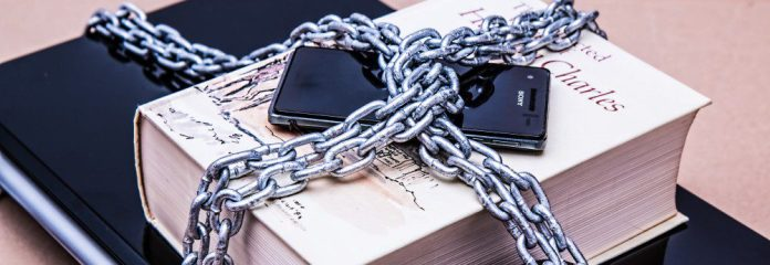 free information chained book smartphone notebook technology censorship learning