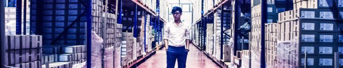 Man Standing in Storage Area Factory Photoshoot Male Model Inside Building Industrial