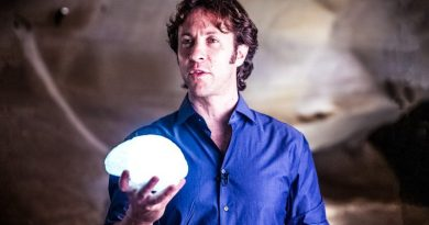 David Eagleman BrainCheck Holding Brain Man Standing Looking NeuroTech Neuroscience
