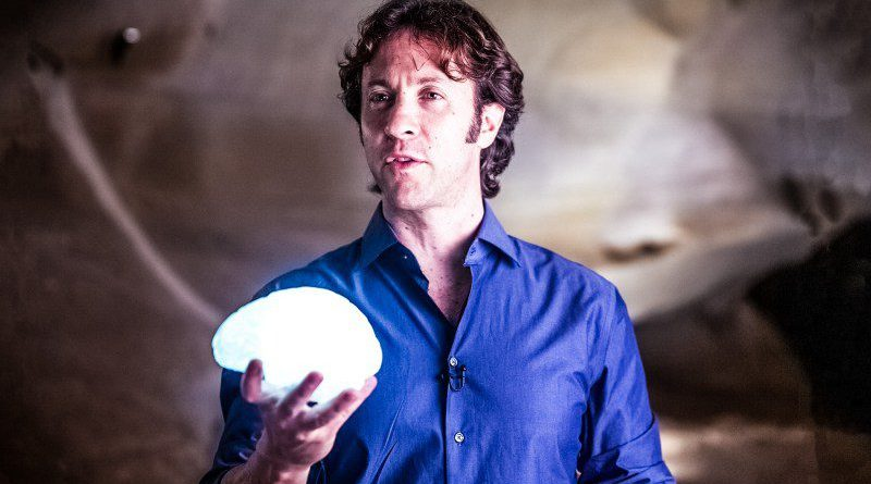David Eagleman BrainCheck Holding Brain Man Standing Looking NeuroTech Neuroscience