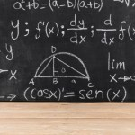 chalkboard with mathematical equations written on it