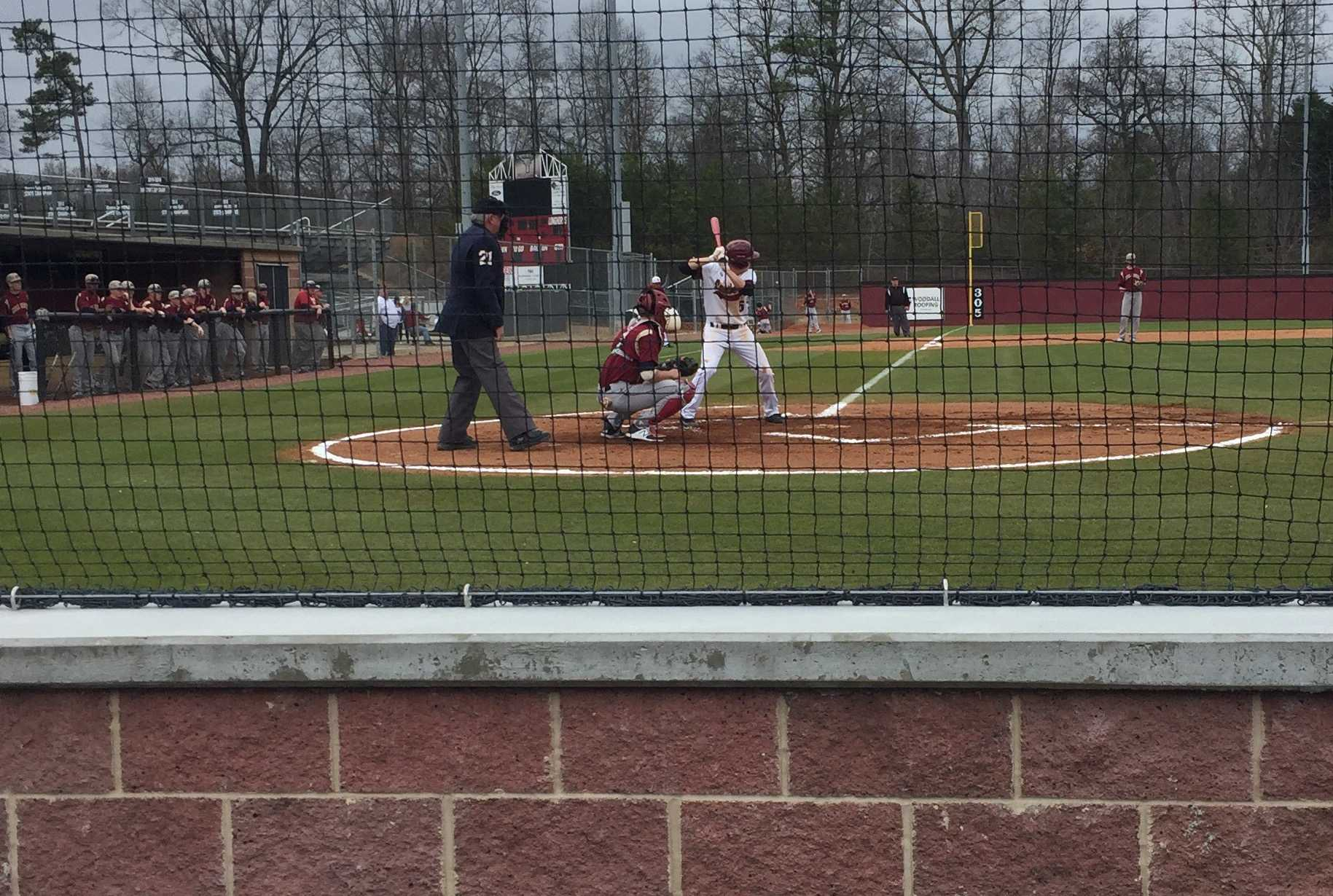 Senior baseball player Josh McAllister hits during a recent home game (Photo taken by Colin Masterson)