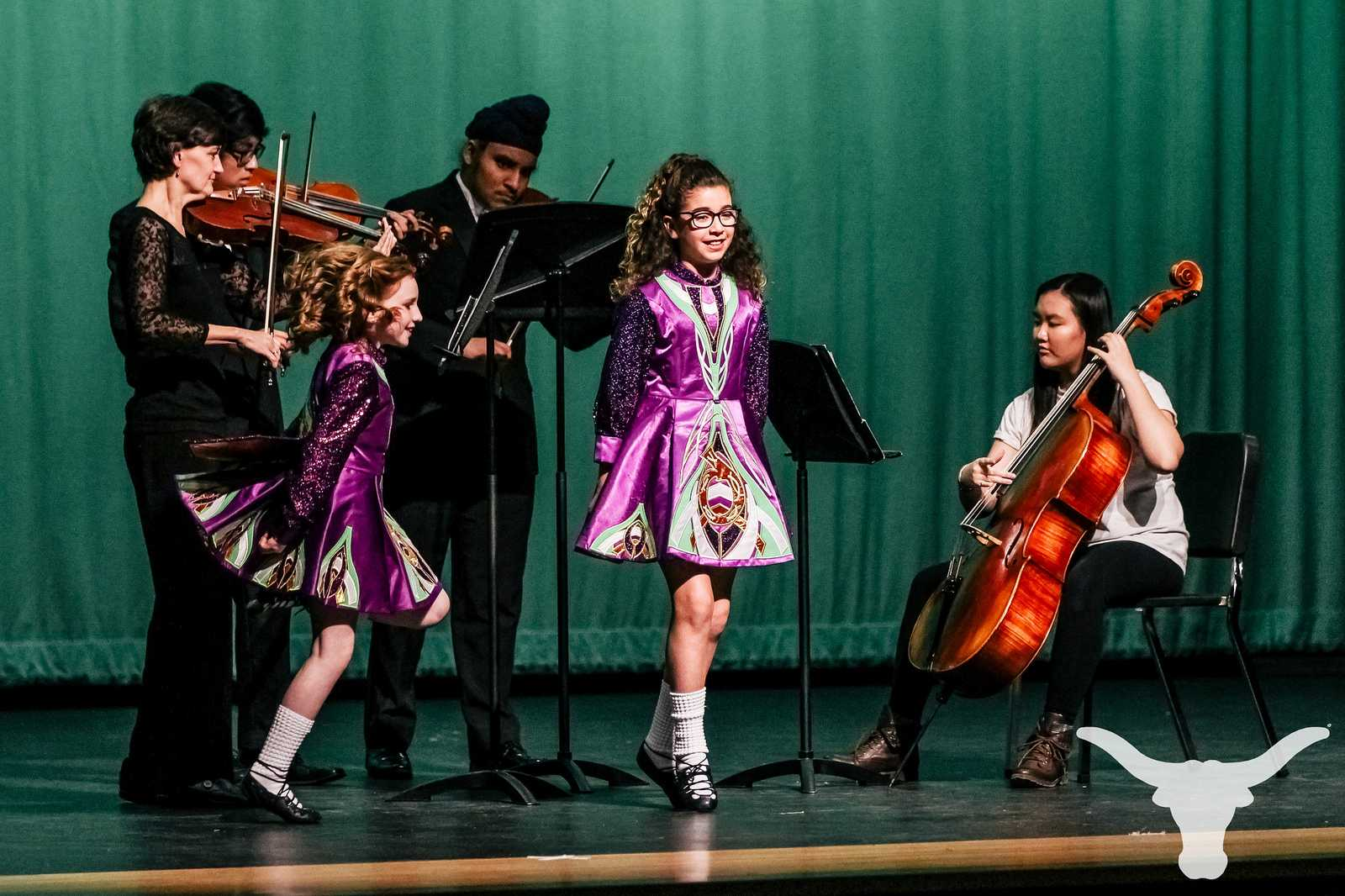 The Lambert Orchestra and two dancers from the Drake School of Irish Dance perform two Irish pieces at International Night.