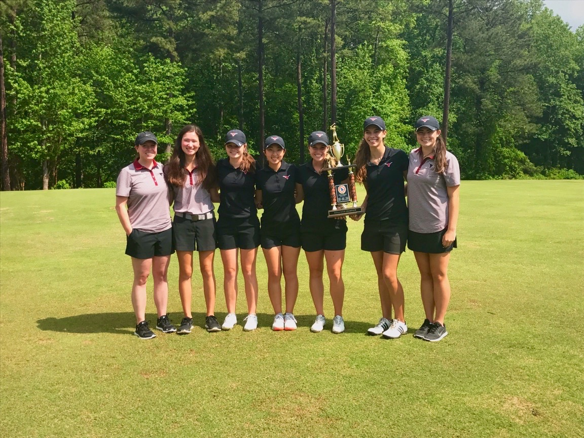 All+smiles+for+the+golf+team+with+their+eighth+consecutive+region+championship.+