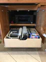 Printer and pull-out storage tray