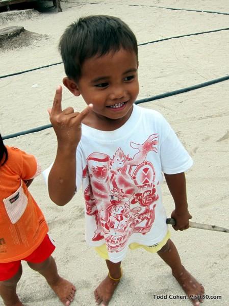 Original Baby Rockstar perfects a new pose - Mabul Island - Malaysian Borneo