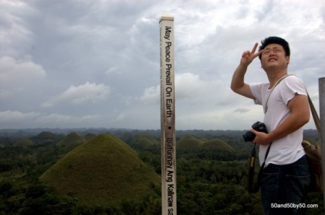"Photo by Todd L Cohen. Sign/pole reads: ""May Peace Prevail on Earth"" 