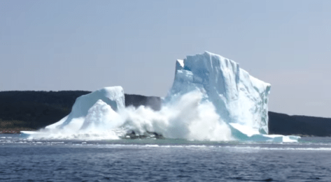 Iceberg collapse in Newfoundland, Canada