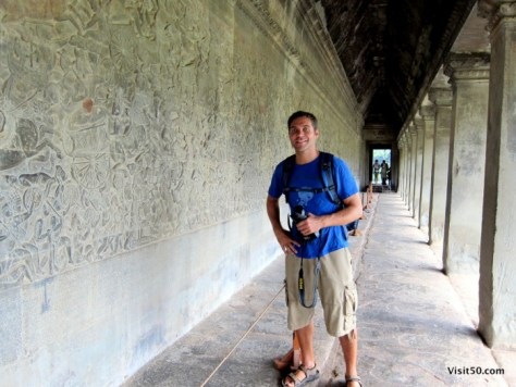 the walls of Angkor Wat are filled with details carvings, each depicting the rich history