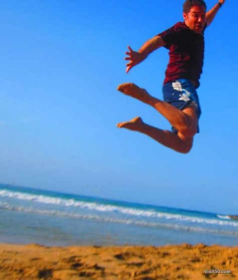 Jumping pic on Red Frog Beach, one of the most popular beaches while Island hopping in Bocas del Toro Panama