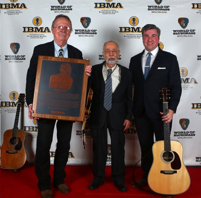 "Roland White (center) at the International Bluegrass Music Association awards show in Raleigh in September, when he accepted the IBMA Hall of Fame award on behalf of his late brother Clarence, the legendary guitar player. (Clarence and Roland, late brother Eric, Billy Ray Latham and LeRoy McNees were the Country Boys in the ""Mayberry on Record"" episode of TAGS. All but Roland, who had joined the Air Force, also were in the epilogue of ""Quiet Sam."" All but Eric went on to form the Kentucky Colonels. Clarence later joined The Byrds. Holding the Hall of Fame plaque is Herb Perdesen, a longtime member of The Dillards. At right is top bluegrass performer Patrick Sauber. Photo by Dave Brainard."