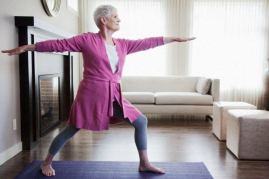 Woman doing yoga at home Partner yoga after 65 A list of dos and don'ts yoga woman seniordating.org