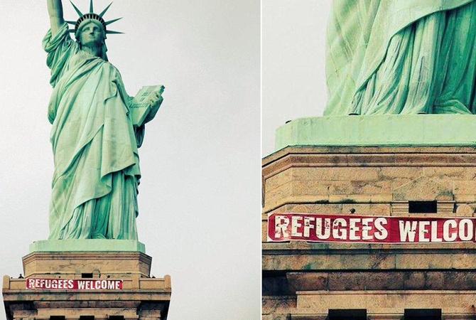 Настатуе Свободы появился баннер «Беженцы, добро пожаловать»
