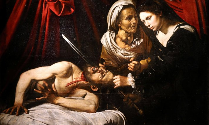 The painting Judith Beheading Holofernes at its presentation in Paris. Photograph: Charles Platiau/Reuters