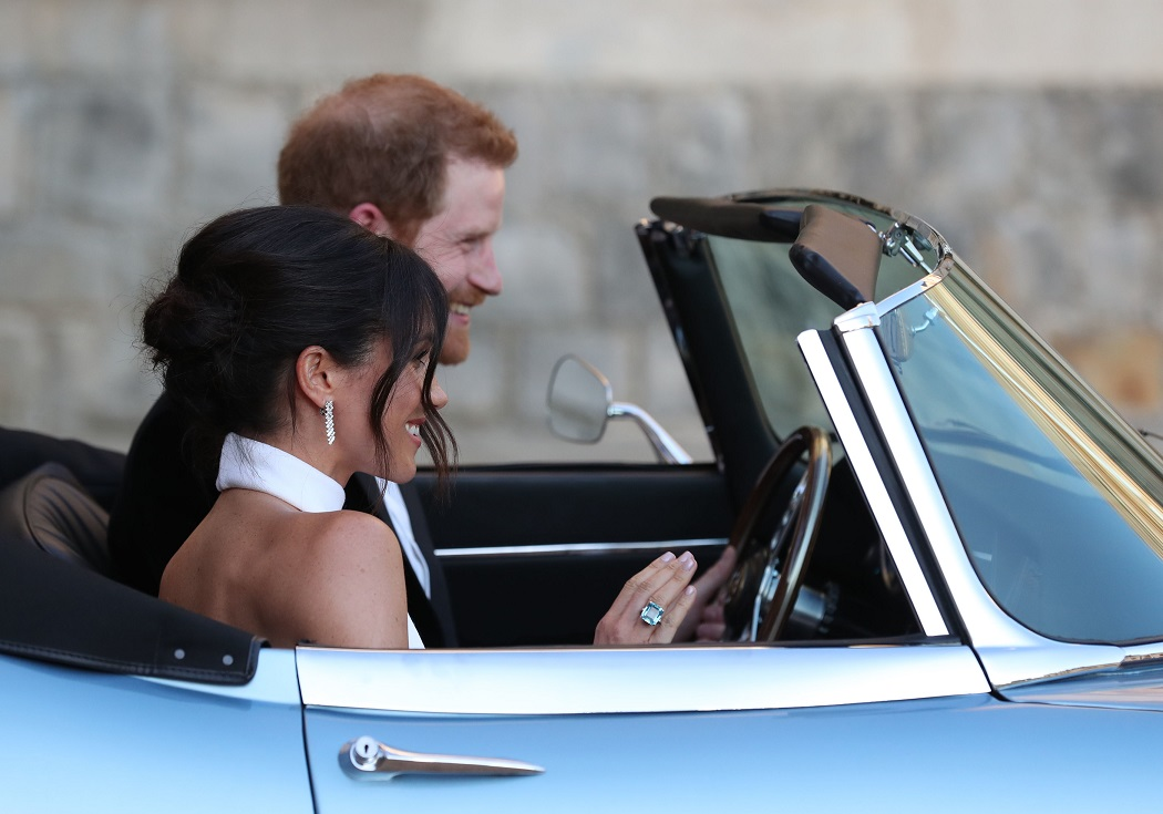 May 19, 2018 - Windsor, Windsor, United Kingdom - Image licensed to i-Images Picture Agency. 19/05/2018. Windsor, United Kingdom. The newly married Duke and Duchess of Sussex, Meghan Markle and Prince Harry, leaving Windsor Castle in an open top sports car after their wedding to attend an evening reception at Frogmore House, hosted by the Prince of Wales. (Credit Image: Global Look Press via ZUMA Press)
