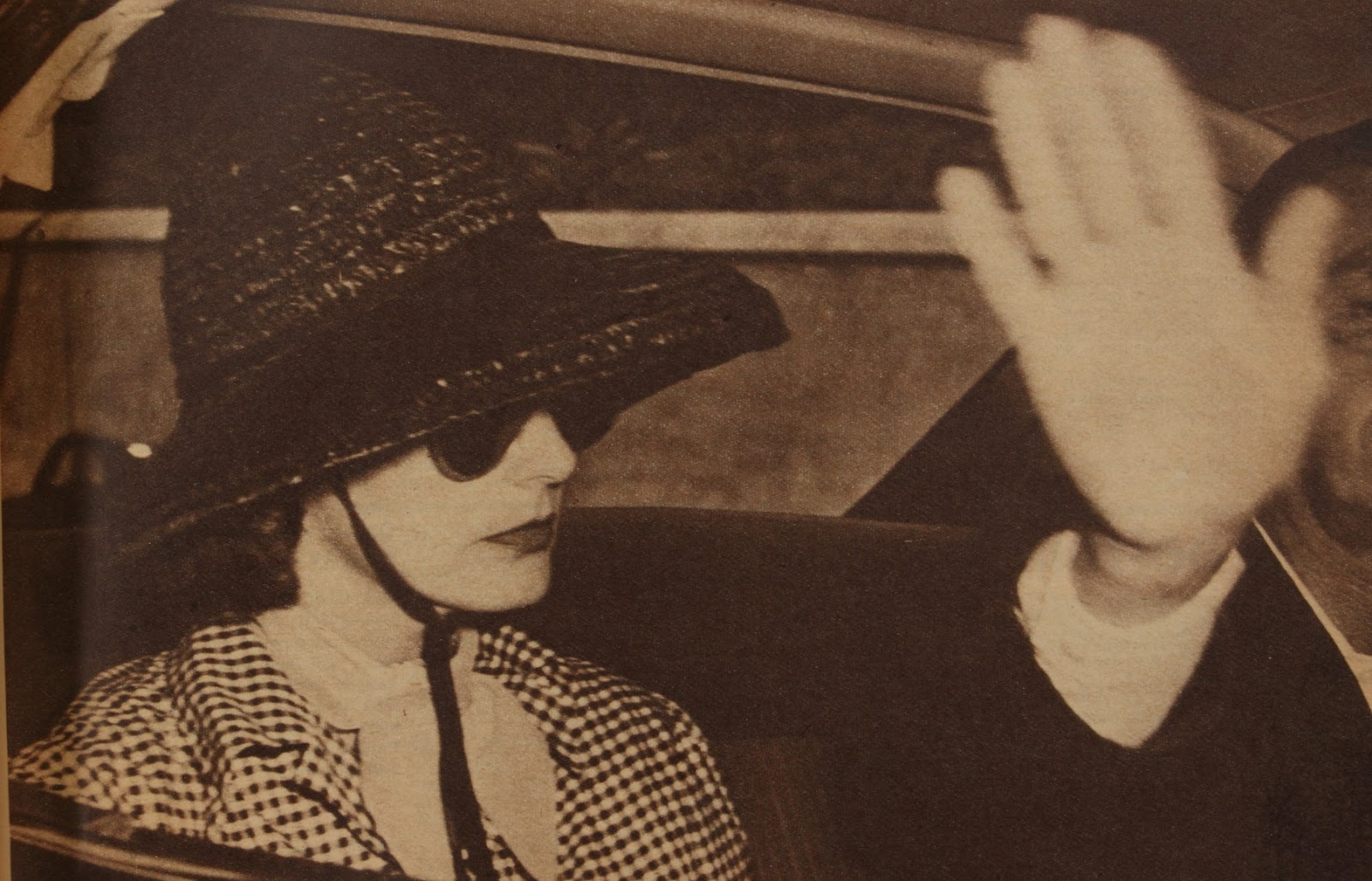 Newspaper clipping of Greta Garbo with Black Hat