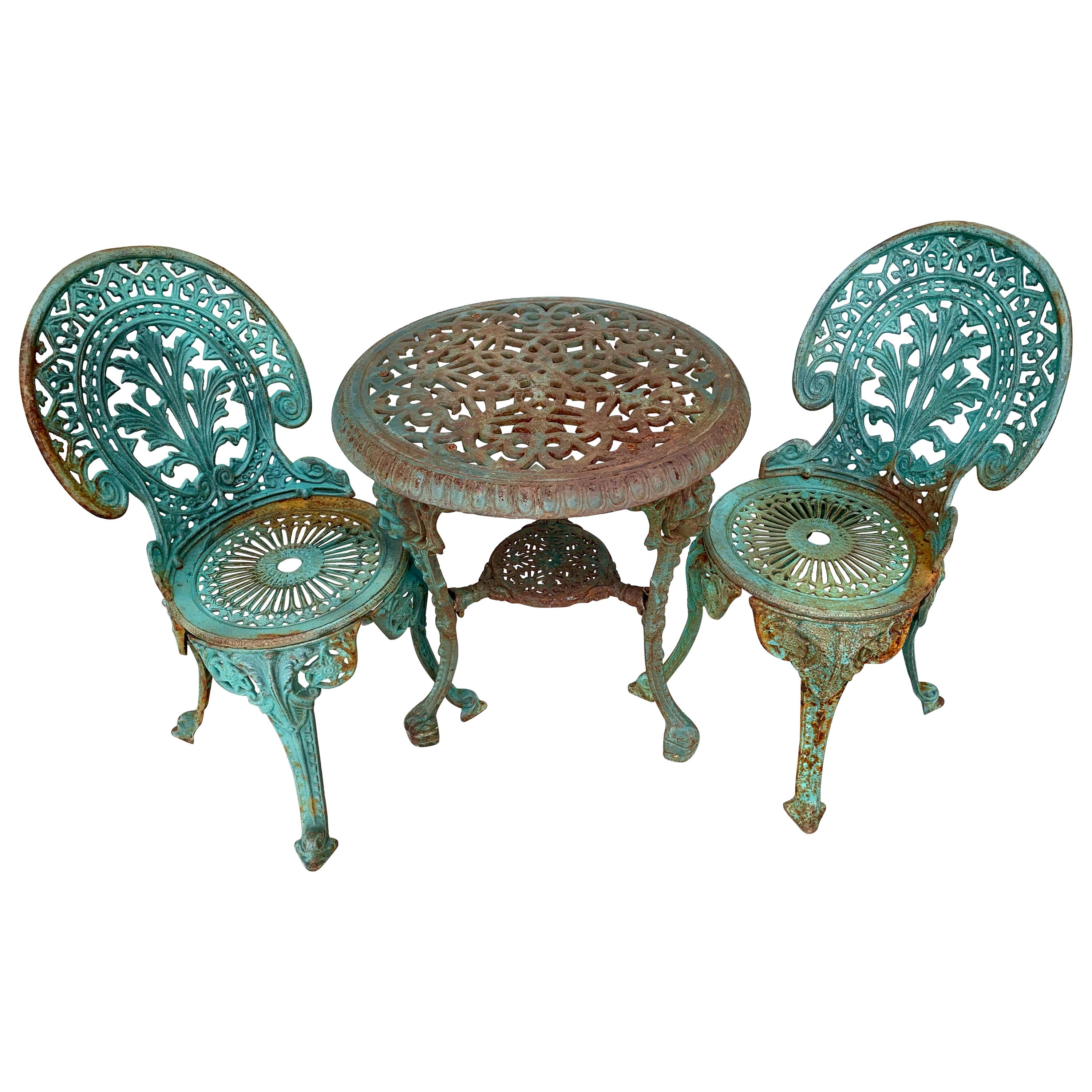 antique green cast iron outdoor bistro set table and two chairs