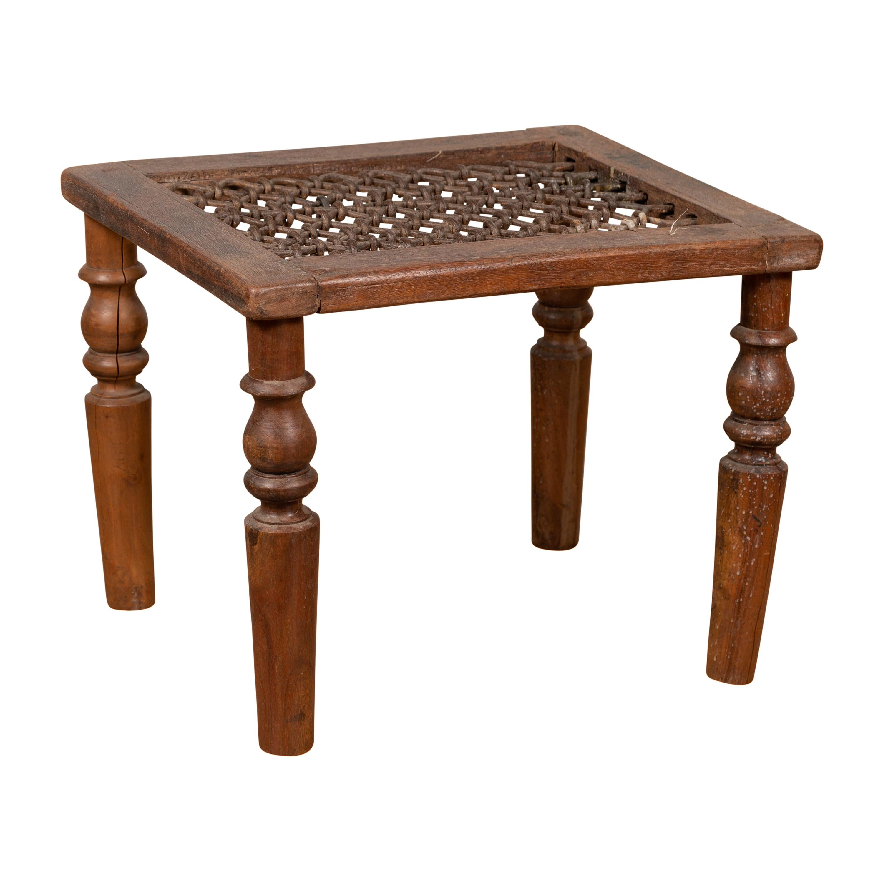 antique indian window grate made into a coffee table with turned baluster legs