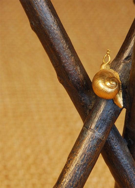 gold snail on table leg