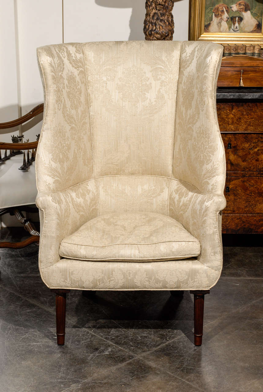 1920s Large Barrel Back Upholstered Wing Chair Raised On
