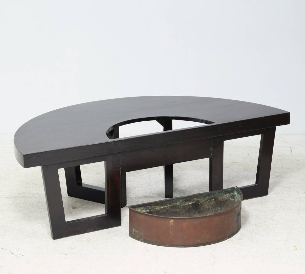 harvey probber style semi circle coffee table with inserted copper planter