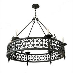 Large Round Wrought Iron Chandelier With Modified Fleur De Lis Pattern Detailing