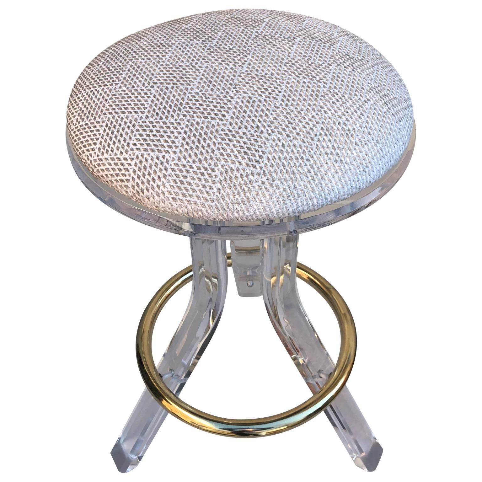 single 1970s lucite vanity stool with brass foot rest