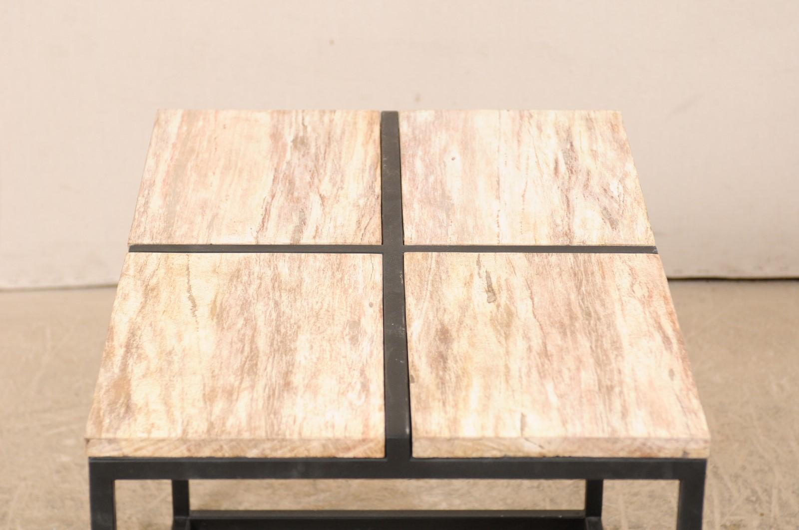 cream colored petrified wood top coffee table with custom iron base