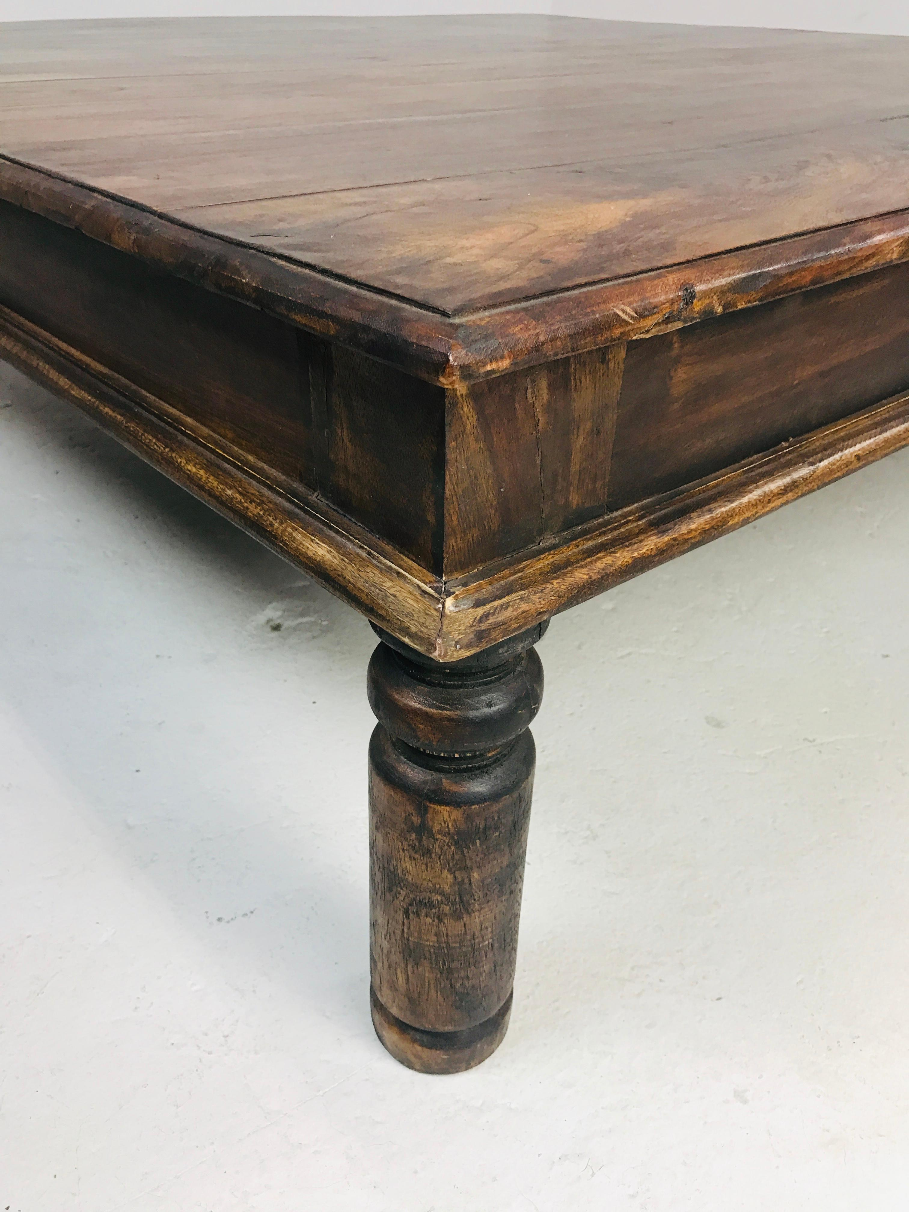 oversized rustic rosewood coffee table