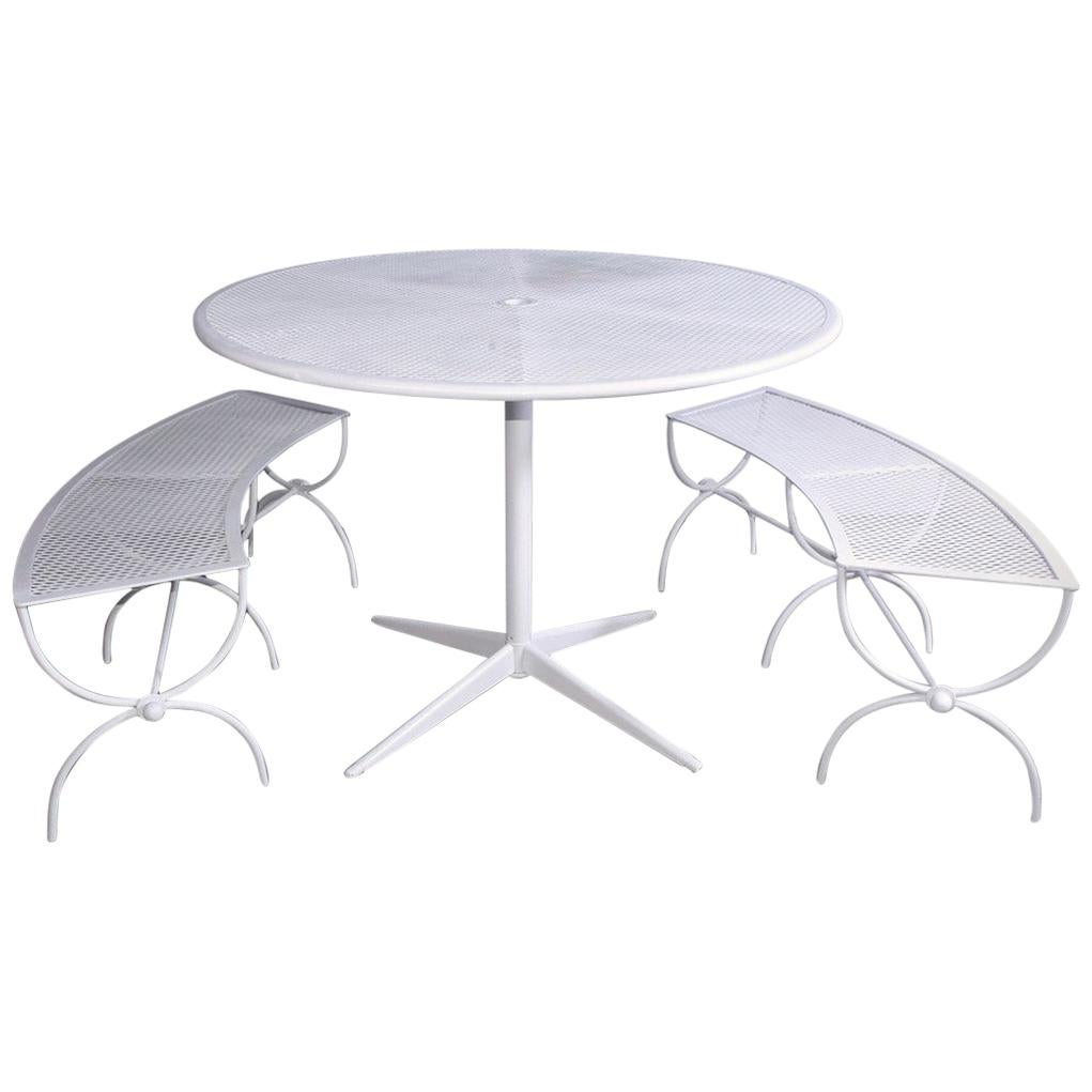 round metal patio table and two matching benches by woodard