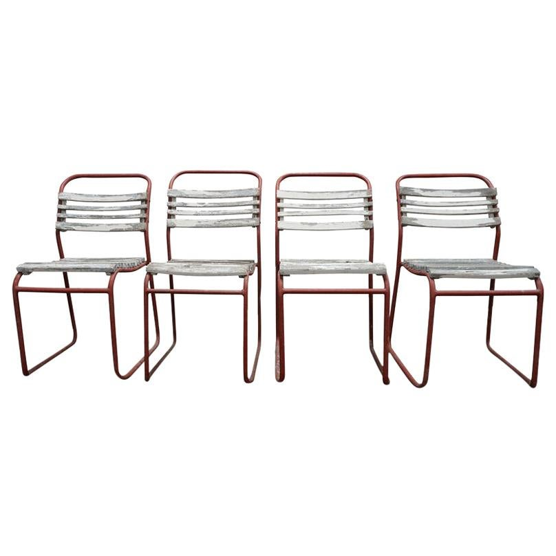 set of european metal and wood outdoor dining chairs