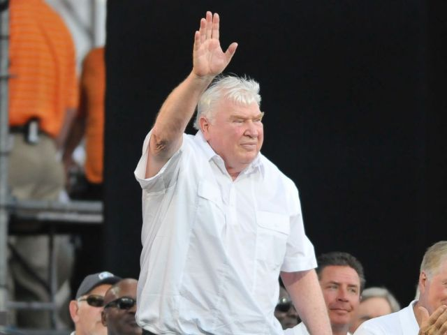 PHOTO: Former NFL coach John Madden waves to the crowd after being introduced before the 2012 Pro Football Hall of Fame Enshrinement ceremony on August 4, 2012, at Fawcett Stadium in Canton, Ohio.