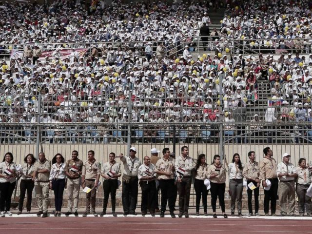 PHOTO: Faithful wait for the arrival of Pope Francis at the Air Defense Stadium in Cairo, April 29, 2017.