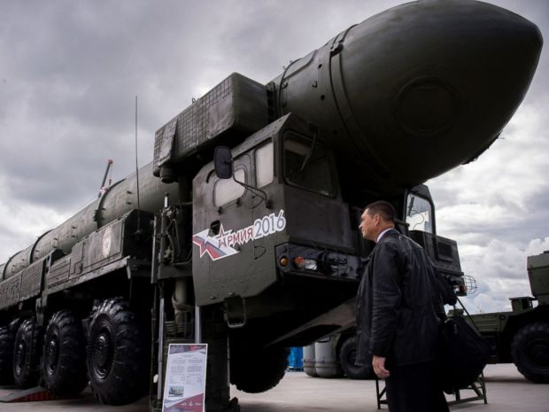 PHOTO: A man looks at a Russian Topol intercontinental ballistic missile launcher at the permanent exhibition of military equipment and vehicles at Patriot Park in Kubinka, outside Moscow, Sept. 8, 2016.