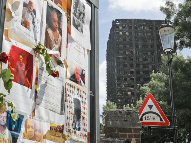 PHOTO: Pictures of missing people on a message board near to the burnt Grenfell Tower apartment building in London, June 23, 2017.