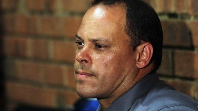 PHOTO: Investigating officer Hilton Botha, sits inside the court witness box during the Oscar Pistorius bail hearing at the magistrate court in Pretoria, South Africa, Feb. 20, 2013.