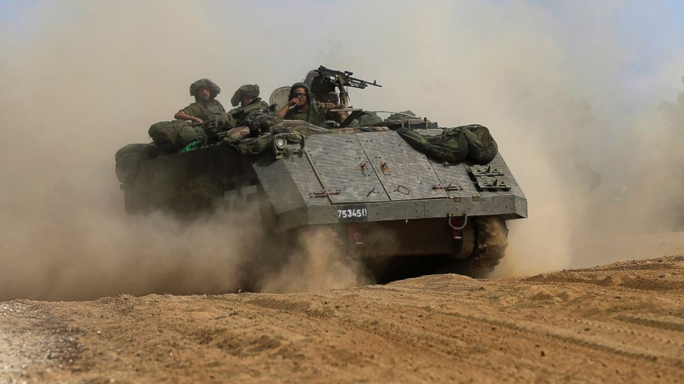 PHOTO: An Israeli armored personnel drives along the Israel and Gaza border, July 13, 2014.