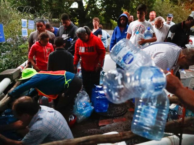 PHOTO: Residents collect drinking water from a mountain spring collection point in Cape Town, South Africa, Jan. 31, 2018.