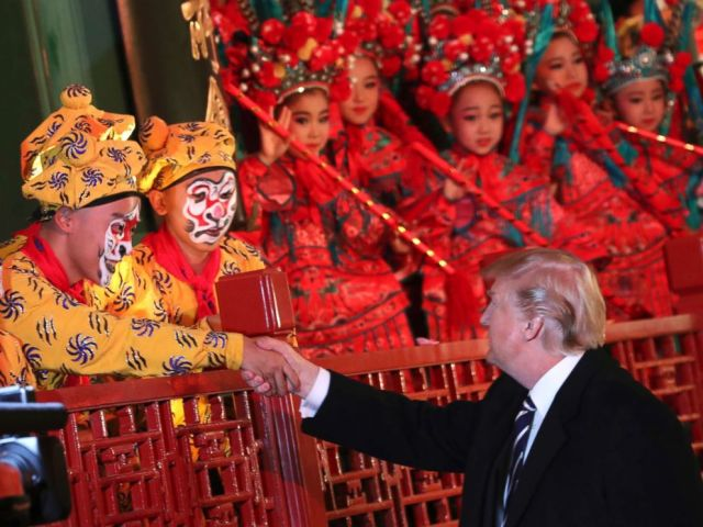 PHOTO: President Donald Trump shakes hands with an opera performer during a tour of an opera performance at the Forbidden City, Nov. 8, 2017, in Beijing, China.