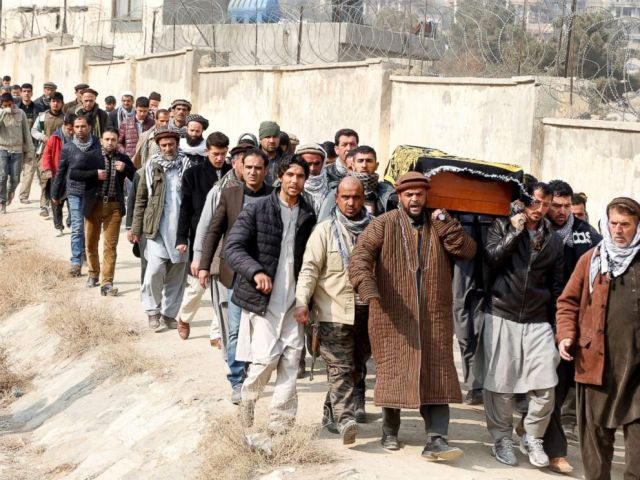 PHOTO: Afghan men carry the coffin of one of the victims of yesterdays car bomb attack at in Kabul, Afghanistan, Jan. 28, 2018.