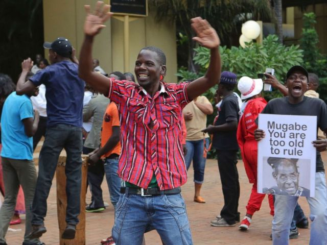 PHOTO: Zimbabweans celebrate in Harare, Tuesday, Nov, 21, 2017, after the resignation of President Robert Mugabe.