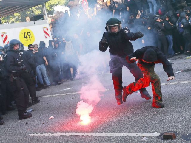PHOTO: German riot policemen catches protester during the demonstrations during the G-20 summit in Hamburg, Germany, July 6, 2017.