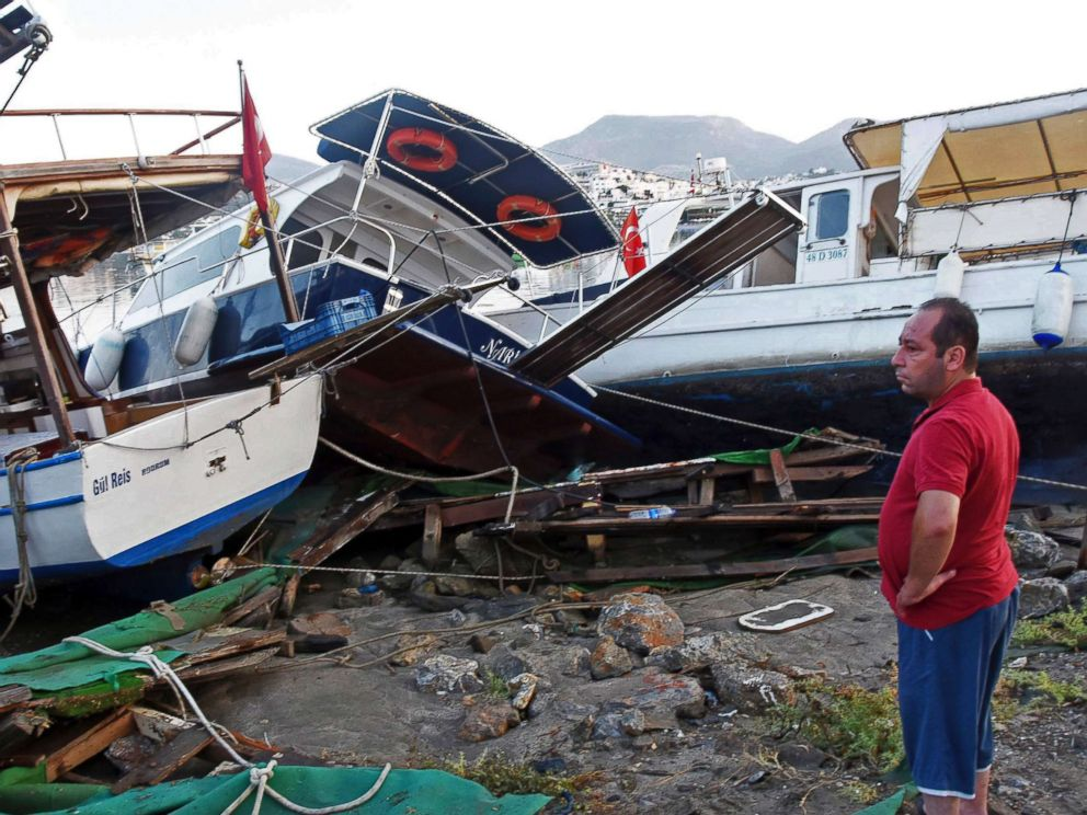 PHOTO: A man looks at boats that crashed on top of each other in the harbor as a result of the overnight earthquake in Bodrum, Turkey, July 21, 2017.