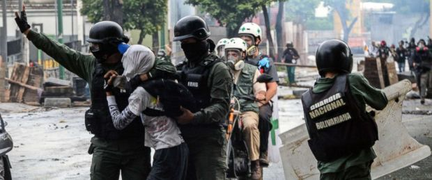 PHOTO: An anti-government activist is arrested during clashes in Caracas, July 28, 2017.