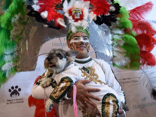 PHOTO: Miguel Garcia with his dog dressed in the fashion of Mexico posed during the 14th Annual New York Pet Fashion Show, Feb. 9, 2017.