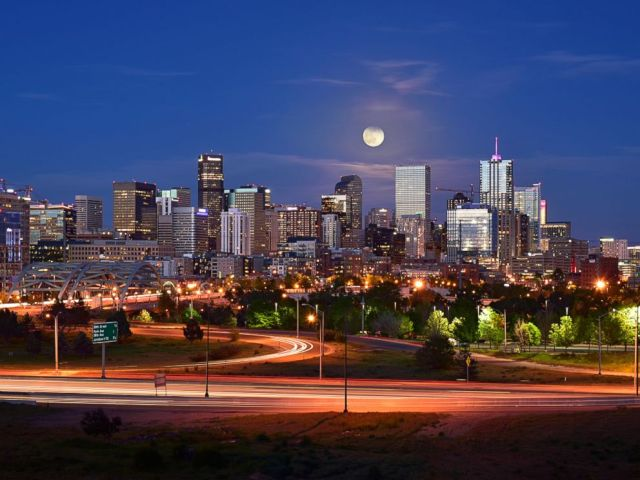 PHOTO: This image was taken when the full moon rose behind the Denver skyline, May 21, 2016.